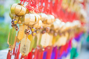 Obraz Golden bell at Wong Tai Sin Temple people wish and hang it on ro - fototapety do salonu