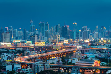 Highway S curved with Bangkok city downtown background at twilight