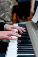 Male hands playing the piano, press the keys, music concept
