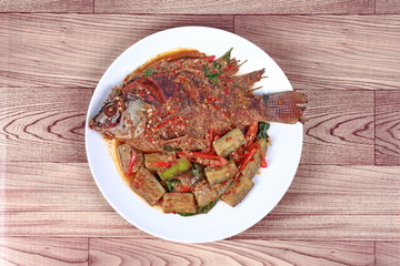 Thai Recipes : Deep-fried tilapia fish  topped Spicy fried eggplant.