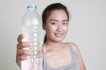 Young woman drinking water on white background.