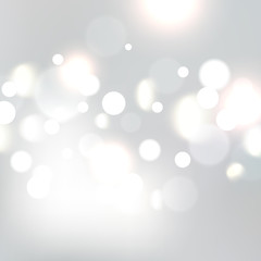 Christmas bokeh background defocused lights. Xmas silver bokeh vector illustration