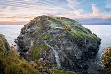 Tintagel, United Kingdom - August 12, 2016: View of Tintagel Island and legendary Tintagel castle ruins at sunset
