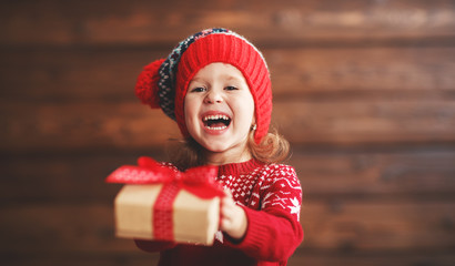 happy child girl with Christmas present