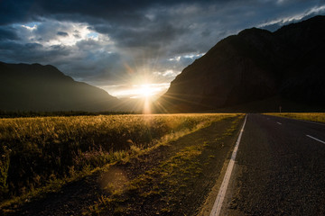 Asphalt winding road in the mountainous area in the summer and s