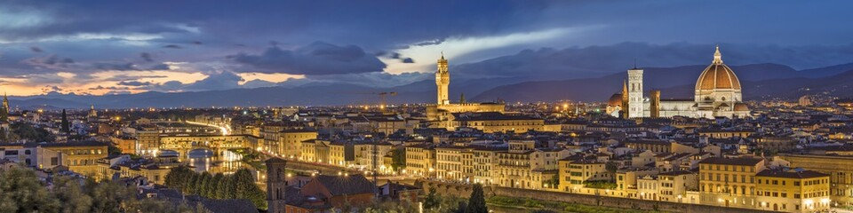 golden panorama of night Florence in Italy