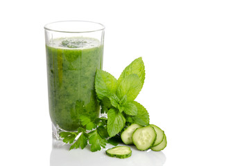 Green smoothie with cucumber, mint and parsley as healthy summer