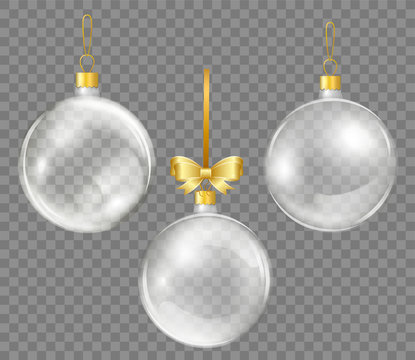 Glass transparent Christmas ball with gold ribbon. Shiny New year toys for decoration.