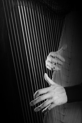 Harp strings Hands playing musical instruments.