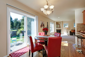 Dining area with nice red leather chairs