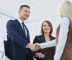Business man shaking hand to partner