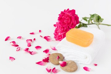 Spa concept with tamarine soap,towel,zen stone and beautiful ros