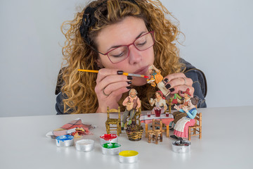 People at the table in miniature