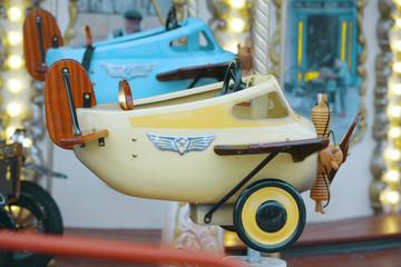 old children's carousel plane