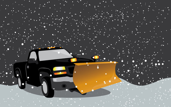 Black pick up truck with snow plow in a snow storm