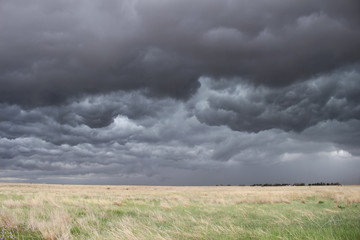 The sky turns dark and turbulent as a storm approaches in the high plains of eastern Colorado.