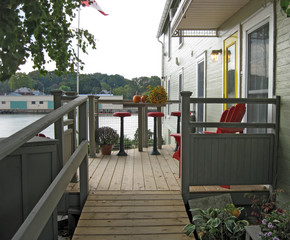 Small deck with table and stools overlooking the harbor.
