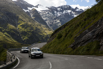 On the mountain highway. The picturesque road with views of snow-covered tops of mountains in national park of Austria.