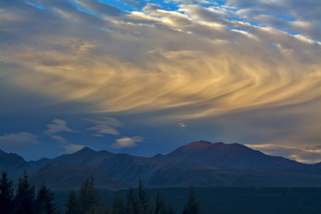 Rolling clouds above mountains before sunset, Aoraki Mount Cook National Park, New Zealand