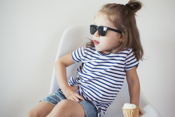 toddler girl have fun with ice cream