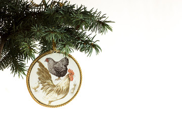 Happy New Year 2017 of rooster card with hand made craft decoupage vintage rooster and chicken on Christmas tree  branch isolated on white background. Copyspace place for text and logo.