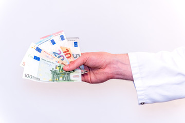Physician Pharmacist takes payment as Euro banknotes in cash