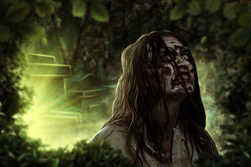 The shouting female zombie. Cemetery. Halloween.