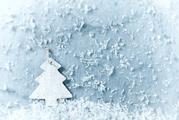 White Christmas tree in snow