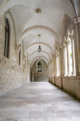 The austere hallway of the Dominican Monastery in the old town of Dubrovnik, Croatia.