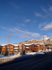 Western style condominiums, with blue winter sky,  Steamboat Springs, Colorado