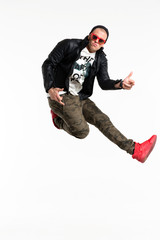Casual fashion man posing in the air on white background