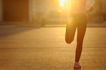Running stretching - runner wearing smartwatch.