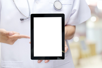 Male doctor holding and pointing blank digital tablet isolated o