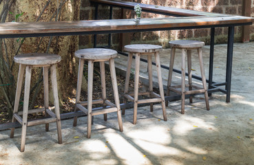 Outdoor wooden tables and chairs