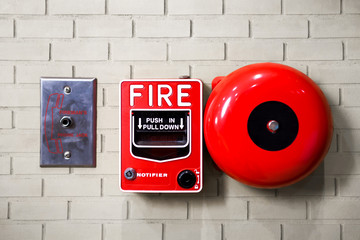 Fire alarm switch on brick wall texture background..
