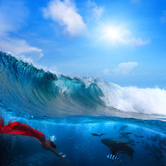 mermaid with red tail and shark underwater breaking wave above