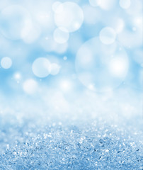Winter abstract background with ice crystals and light flares