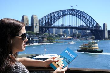 Woman traveller looks at Sydney Harbour Bridge Sydney Australia
