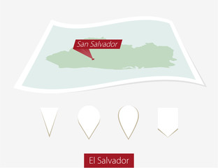 Curved paper map of El Salvador with capital San Salvador on Gray Background. Four different Map pin set. Vector Illustration.