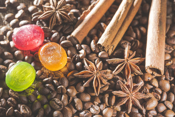 Anise stars , coffee beans, cinnamon sticks and colorful candies
