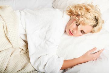 beautiful woman asleep in bed