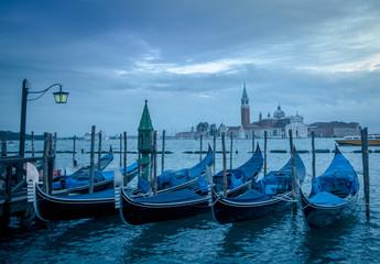 Gondolad in Venice with the church San Giorgo Maggiore in the ba