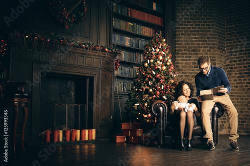 Young family in living room on Christmas night