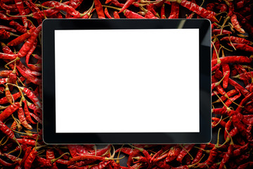 Blabk screen of tablet over Red Chili Pepper,Pill of Dried Chillies Background.