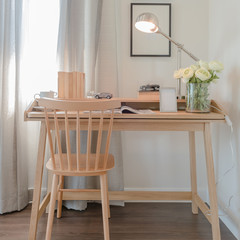 wooden chair and table with modern lamp in working space interio