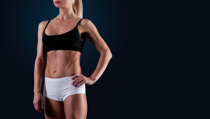 Close up portrait of fitness athletic young woman bodybuilder