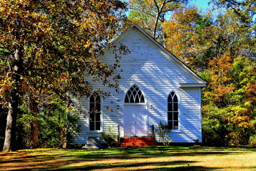 Farriington, North Carolina - November 5, 2016:  Circa 1900 O'Kelly Chapel Christian Churcn white clapboard gothic revival one room rural chapel with lancet windows