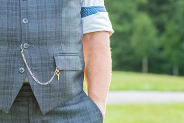 Elegant gentleman's suit with chain for pocket watch