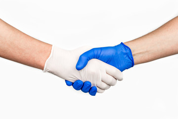 Handshake with blue and white medical gloves, profile view on white background.
