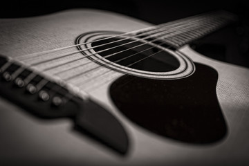 Acoustic guitar closeup in black and white